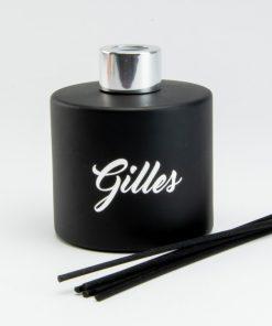 Parfumfles zwart met zilverkleurige dop met stokjes